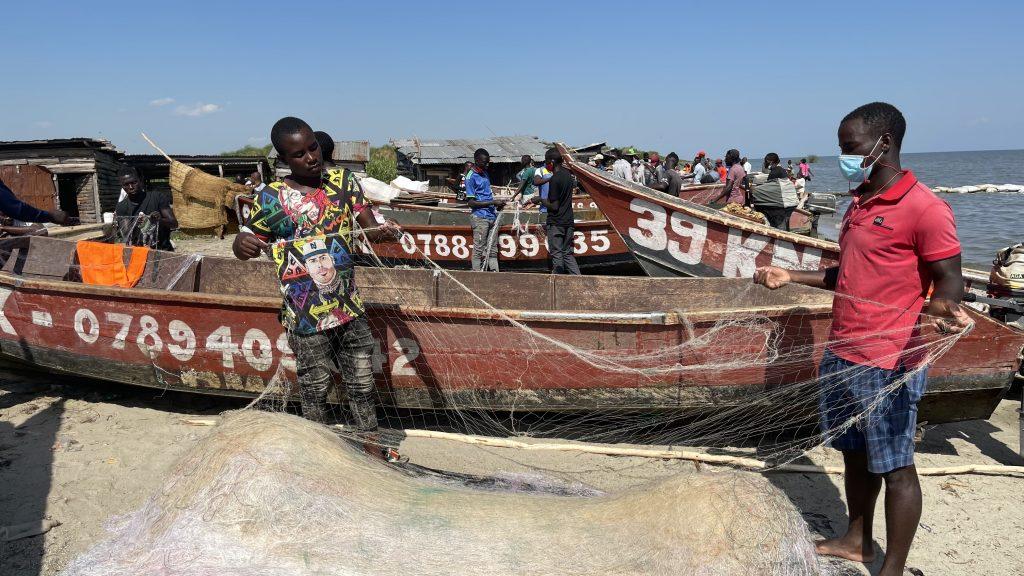 Amperaza Amuzan untangles the fishnets at the Rwenshama fish landing site at Lake Edward in Uganda